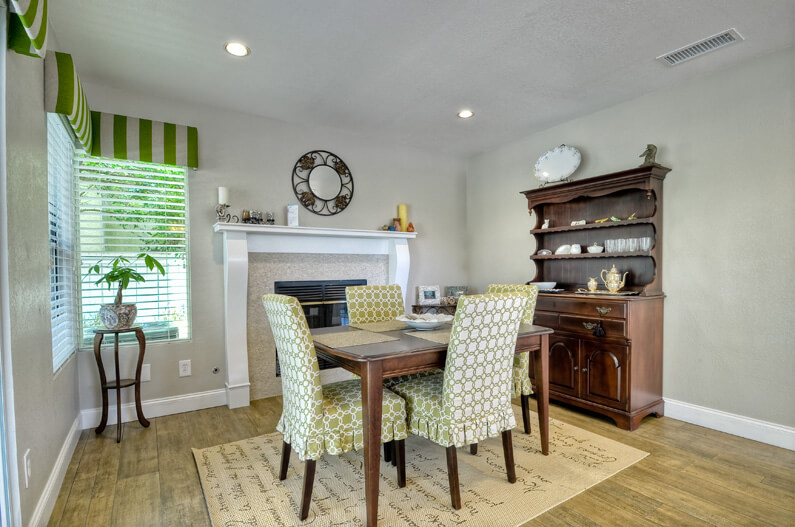 formal dining room with upgraded fireplace