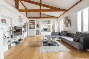 white walls with wood beam exposed posts and wood flooring