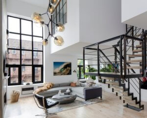 bright living area with metal stairway