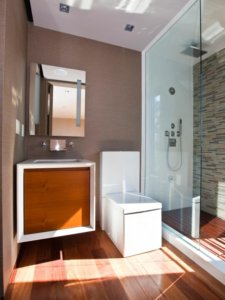 small bathroom with shower including rain shower head and wall mounted sink