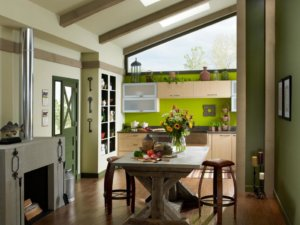 japanese home design with small dining area leading into kitchen with green backsplash