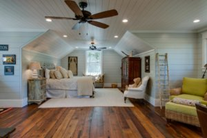 living area leading to bedroom area in cottage style house